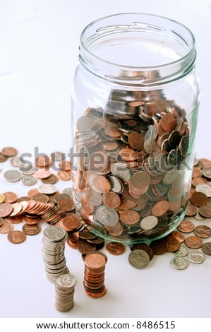 Jar of coins, stacks and scattered coins around jar, white background