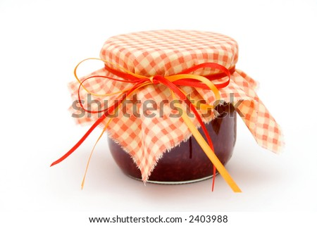 Jar of fresh homemade raspberry jam on white background - stock photo