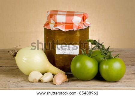 jar of home made green tomato chutney - stock photo