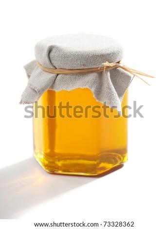 Jar of honey - stock photo