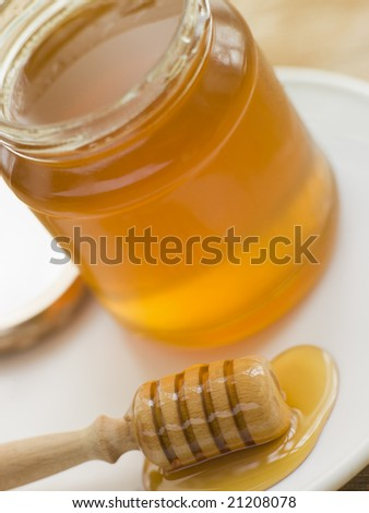 Jar Of Honey And Spoon