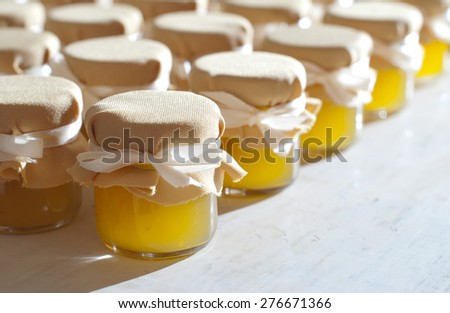 Jar of honey on white table jam confiture marmalade pozzy ??????? make conserve preserve - stock photo