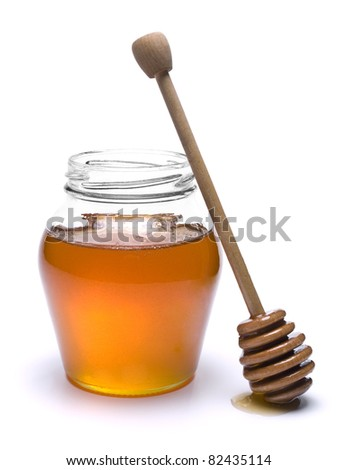 Jar of honey with a wooden drizzler a side. Isolated on white background. - stock photo