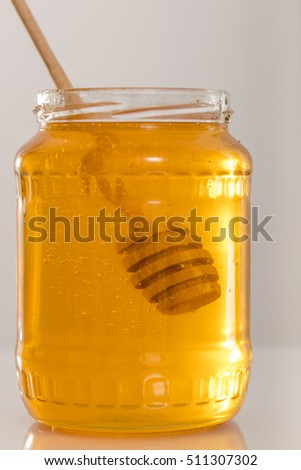 Jar of honey with honey dipper 5