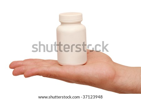 jar of medicine in the palm - stock photo