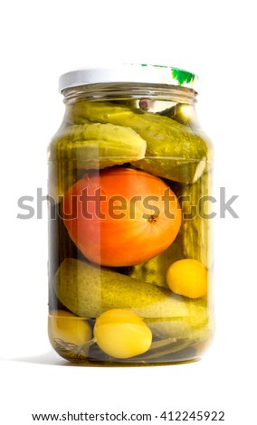Jar of pickled cucumbers and tomatoes on a white background - stock photo