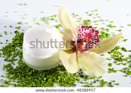 jar of сream and orchid - stock photo