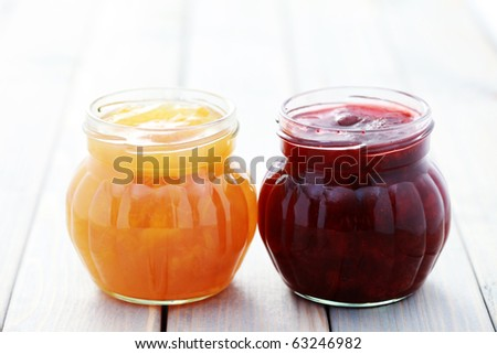 jar of strawberry and apricot jam - food and drink - stock photo