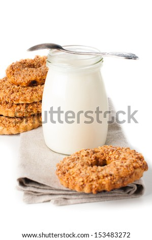 Jar of yogurt and nut cookies on a white background isolated
