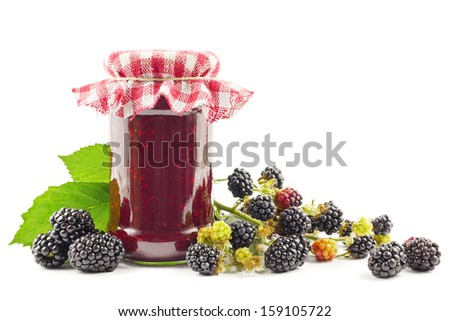 Jar with blackberry jam with fresh blackberries on white