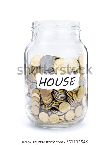 Jar with coins on House, money isolated on white. - stock photo