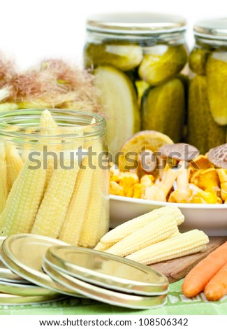 Jar with corn  and other vegetable preparing for preserving. - stock photo