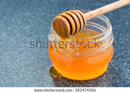jar with fragrant honey, close-up - stock photo