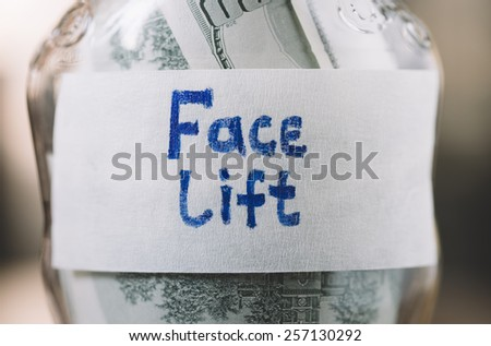 jar with money in closeup - stock photo