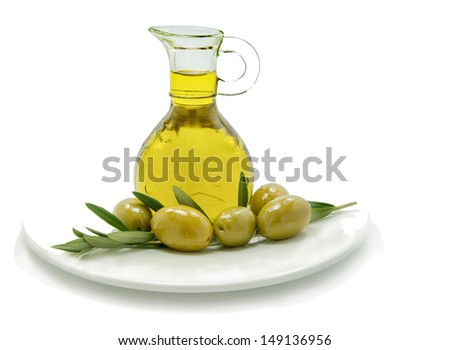 Jar with olive oil and fruit isolated on white background