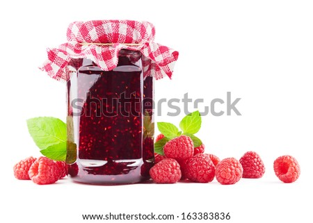 Jar with raspberry jam with raspberries on white - stock photo