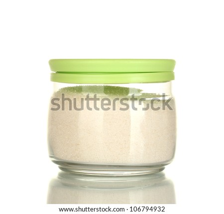 Jar with white crystal sugar isolated on white