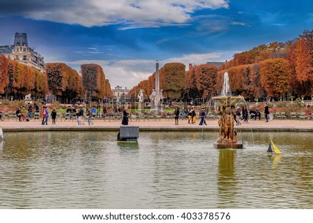 Jardins du Luxembourg, Paris, France in autumn. Orange leafs and multicolored plants. Fountain and lake. Blue Sky./Jardins du Luxembourg, Paris, France - stock photo