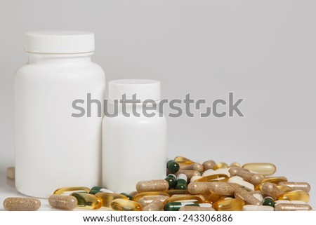 Jars and different colorful pills