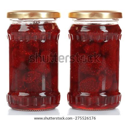 Jars of strawberry jam isolated on white - stock photo