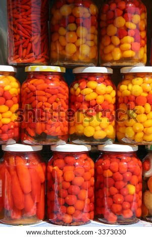 Jars of traditional Brazilian peppers from the state of Goias. - stock photo