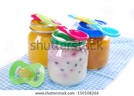 jars with baby food,spoons and dummy isolated on white  - stock photo