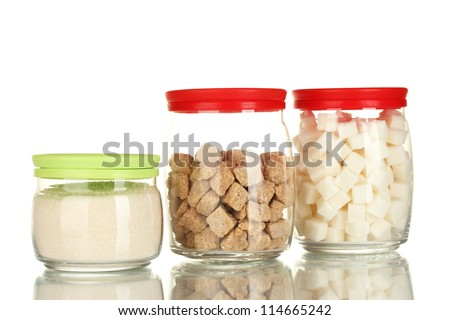 Jars with brown cane sugar lump, white crystal sugar and white lump sugar isolated on white - stock photo