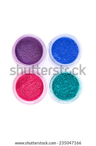 Jars with loose eye shadows in pastel colors, top view isolated on white background  - stock photo