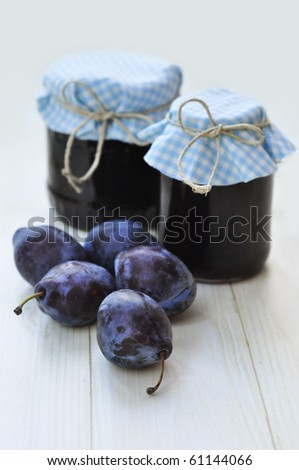 Jars with plum jam - stock photo