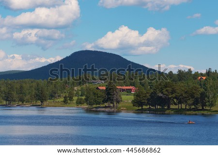 JARVSO, SWEDEN - JUNE 25, 2016: The mountain Jarvsoklacken during summer with red houses in the landscape. - stock photo