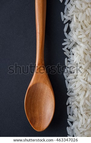Jasmine rice and wooden spoon