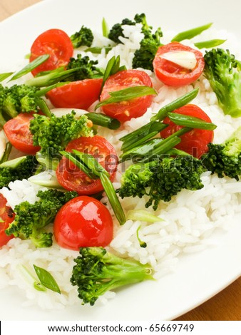 Jasmine rice with cherry tomatoes and broccoli. Shallow dof.