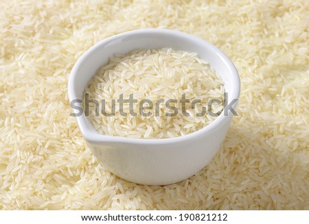 jasmine rice with measured daily dose in the ceramic cup - stock photo