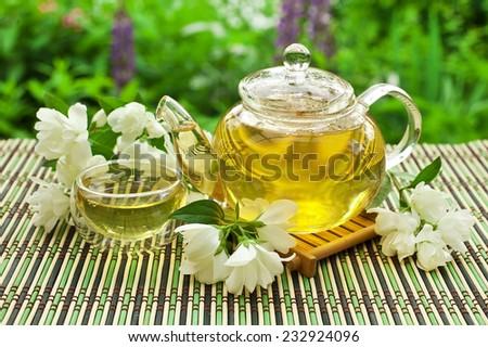 Jasmine tea in a glass teapot  - stock photo