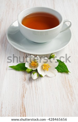 Jasmine tea with jasmine herb flower on wooden table