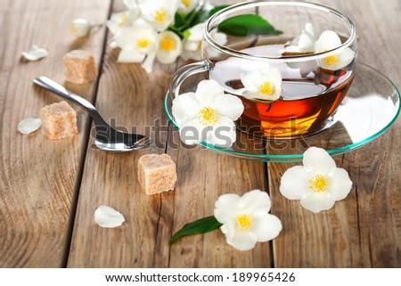 Jasmine tea with jasmine herb flower on wooden table background  - stock photo