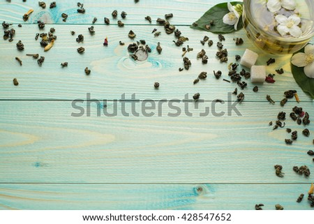 Jasmine tea with jasmine herb flower on wooden table background. Place for your text - stock photo