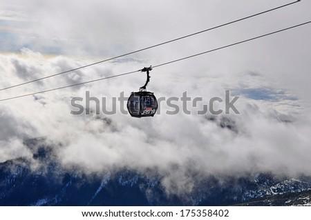 JASNA, SLOVAKIA - JAN 6 : Modern cableway FUNITEL in ski resort Jasna - Low Tatras mountains on January 6, 2014 in Jasna - stock photo