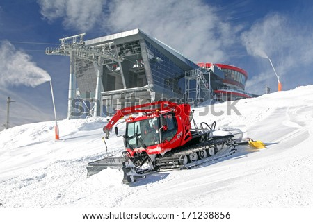 JASNA, SLOVAKIA - JANUARY 13: Modern cableway and groomer on the hill Chopok in ski resort Jasna - Low Tatras mountains on January 13, 2014 in Jasna