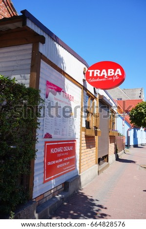 JASTARNIA, POLAND - JUNE 19, 2017: Traba snack bar during closing time by a sidewalk on a sunny day