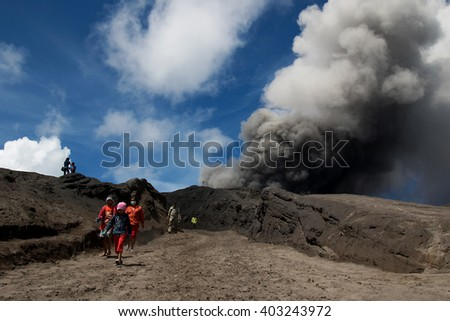 Java, Indonesia - April 3, 2016: Many tourists Travel to Mount Bromo, Mount Bromo is an active volcano and part of the Tengger massif, in East Java, Indonesia. At 2,329 metres. - stock photo