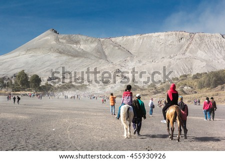 JAVA,INDONESIA-AUGUST 16:Tourist ride horse and walking to see crater of Mount  Bromo on August 16, 2015 in Java , Indonesia.Mt. Bromo is an active volcano and part of the Tenger massif, in East Java. - stock photo