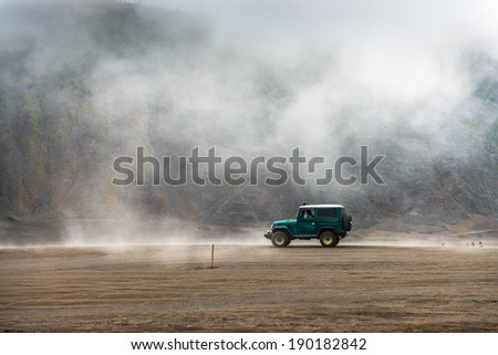 JAVA,INDONESIA - FEB 17: tourist jeep are waiting for their customer at mount Bromo on on February 17, 2013 in Bromo Volcano, Java, Indonesia - stock photo