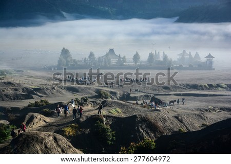 JAVA, INDONESIA - JAN 24, 2013 : Candi Bentar temple, view from crater of mount Bromo on Java island, Indonesia - stock photo