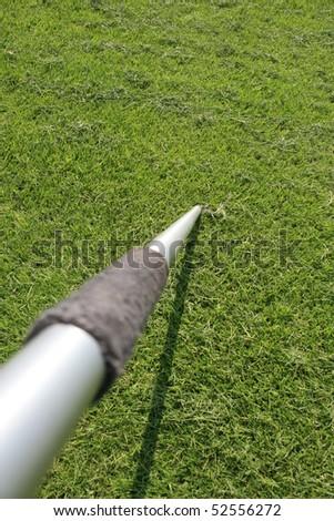 javelin in grass - stock photo
