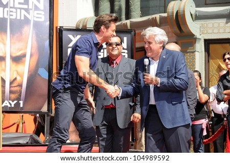 Jay Leno and Hugh Jackman at the ceremony honoring Hugh Jackman with Hand and Footprints in the courtyard of the Grauman's Chinese Theatre. Grauman's Chinese Theatre, Hollywood, CA. 04-21-09 - stock photo