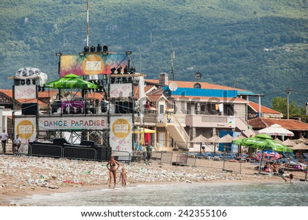 JAZ, MONTENEGRO - JULY 18: Empty beach with litter, after the last day of the SEA DANCE Music Festival - EXIT ADVENTURE, on July 18, 2014  at the Jaz beach near Budva, Montenegro. - stock photo
