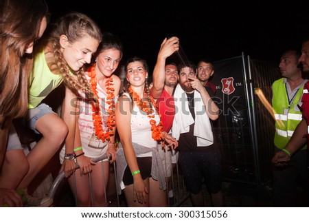 JAZ, MONTENEGRO - JULY 16 2015: RUDIMENTAL DJ taking selfies with fans at SEA DANCE Music Festival - EXIT ADVENTURE, on July 16, 2015 at the Jaz beach near Budva, Montenegro. - stock photo