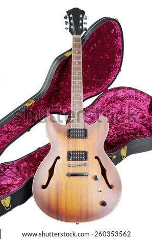 Jazz guitar and case. - stock photo