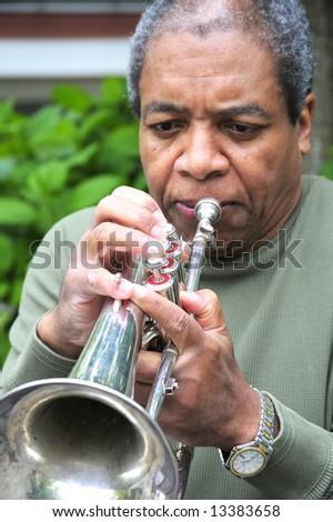 Jazz musician playing a flugelhorn. - stock photo